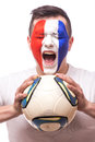 Portrait Football fan of France national football team with ball in hands screaming Royalty Free Stock Photo