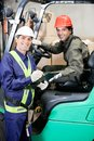Portrait of forklift driver and supervisor young at warehouse Royalty Free Stock Image
