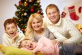Portrait of four happy family members at home on christmas eve Royalty Free Stock Photos