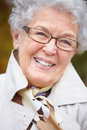 Portrait of a friendly older woman with glasses Royalty Free Stock Photography