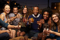 Portrait Of Friends Enjoying Night Out At Rooftop Bar Royalty Free Stock Photo