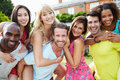 Portrait of friends relaxing in summer garden together close up smiling to camera Stock Photo