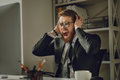 Portrait of a frustrated bearded businessman in eyeglasses screaming Royalty Free Stock Photo