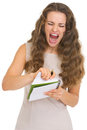 Portrait of frustrated young woman pulls out sheet from notebook Royalty Free Stock Image
