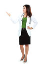 Portrait of full body female doctor showing blank area for sign or copyspace Royalty Free Stock Photo