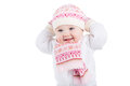 Portrait of a funny baby girl in a knitted hat scarf and mitten isolated on white Royalty Free Stock Image