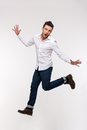 Portrait of a funny casual man jumping Royalty Free Stock Photo