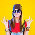 Portrait of funny girl in glasses and a brown hat Royalty Free Stock Photo