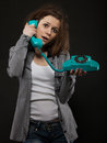 Portrait of the funny girl with old phone Royalty Free Stock Photo