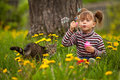 Portrait of funny little girl blowing soap bubbles Royalty Free Stock Images