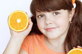 Portrait of funny lovely little girl with orange Royalty Free Stock Photography