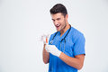 Portrait of a funny male doctor holding syringe Royalty Free Stock Photo