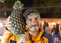 Portrait of funny man with great pineapple Royalty Free Stock Photo