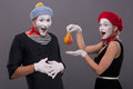 Portrait of funny mime couple with white faces and Royalty Free Stock Photo