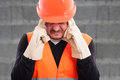 Portrait of fustrated workman with headache Royalty Free Stock Photo