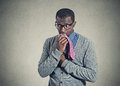 Portrait geeky nervous anxious man bitting chewing his tie Royalty Free Stock Photo