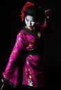 Portrait of geisha dancing with sword Royalty Free Stock Photo