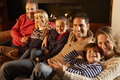 Portrait 3 generation family at home by firelight Royalty Free Stock Photo