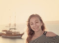 Portrait of a girl on the background of the ocean vintage style Stock Photography