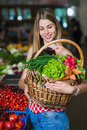 Portrait of a girl with a basket of vegetables