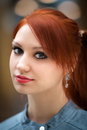 Portrait of the girl a beautiful young with bright red hair Royalty Free Stock Images
