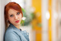 Portrait of the girl a beautiful young with bright red hair Stock Photo