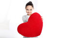 Portrait of a girl with a big heart cute caucasian holding red valentine Royalty Free Stock Images