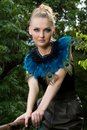 Portrait of girl in blouse with peacock feathers Stock Photos