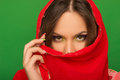 Portrait of a girl covering her mouth with a red handkerchief on the background Royalty Free Stock Photos