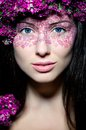Portrait girl with creative make-up and pink flowers Royalty Free Stock Images