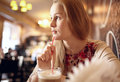 Portrait girl enjoying coffee cafe looking window beautiful vintage interior blur natural sunlight Stock Photography