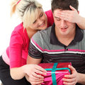 Portrait of a girl giving her boyfriend a gift Royalty Free Stock Photo