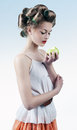 Portrait of a girl in hair curlers studio photo young woman and with apple Stock Photos