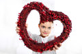 Portrait of a girl with heart cute caucasian holding red valentine Royalty Free Stock Photography