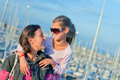 Portrait of a girl with her mother near yachts Royalty Free Stock Photos