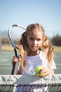 Portrait of girl holding racket and tennis ball Royalty Free Stock Photo