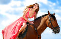 The portrait of a girl on a horse with a beach Royalty Free Stock Photo
