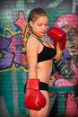 Portrait of a girl with red boxing gloves Stock Photo