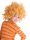Portrait of  girl in red curly wig. Royalty Free Stock Photo