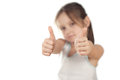 Portrait of a girl showing thumbs up isolated beautiful Stock Photography
