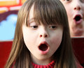 Portrait of girl singing on the playground Royalty Free Stock Photo