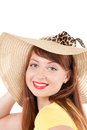 Portrait of the girl in a straw hat young smiling on white background Royalty Free Stock Images