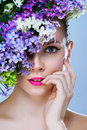 Portrait of girl with stylish makeup and flowers close up around her face Royalty Free Stock Image