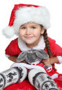 Portrait of girl with toy in santa claus clothes Royalty Free Stock Photo