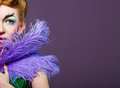 Portrait of girl with unusual make up attractive young a fabulous makeup and feathers close Royalty Free Stock Photos