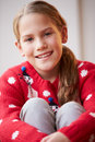 Portrait of girl wearing christmas jumper close up smiling Royalty Free Stock Photos
