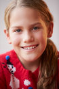 Portrait of girl wearing christmas jumper looking at camera smiling Royalty Free Stock Photos