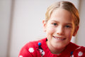 Portrait of girl wearing christmas jumper smiling to camera Stock Photography