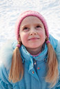 Portrait of a girl in winter clothes Stock Photos