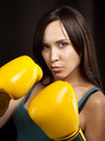 Portrait of a girl in yellow boxing gloves Stock Images